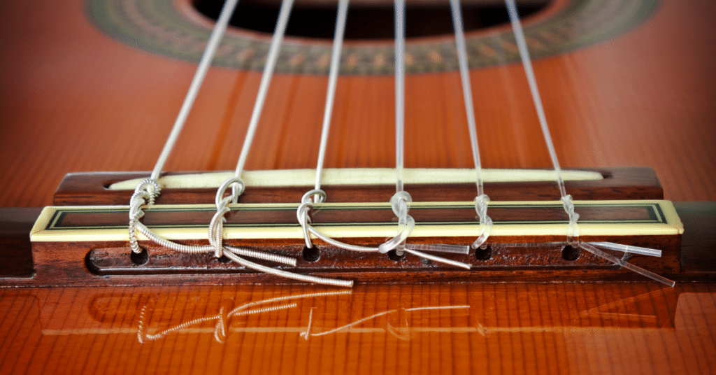 tuning the strings of a guitar